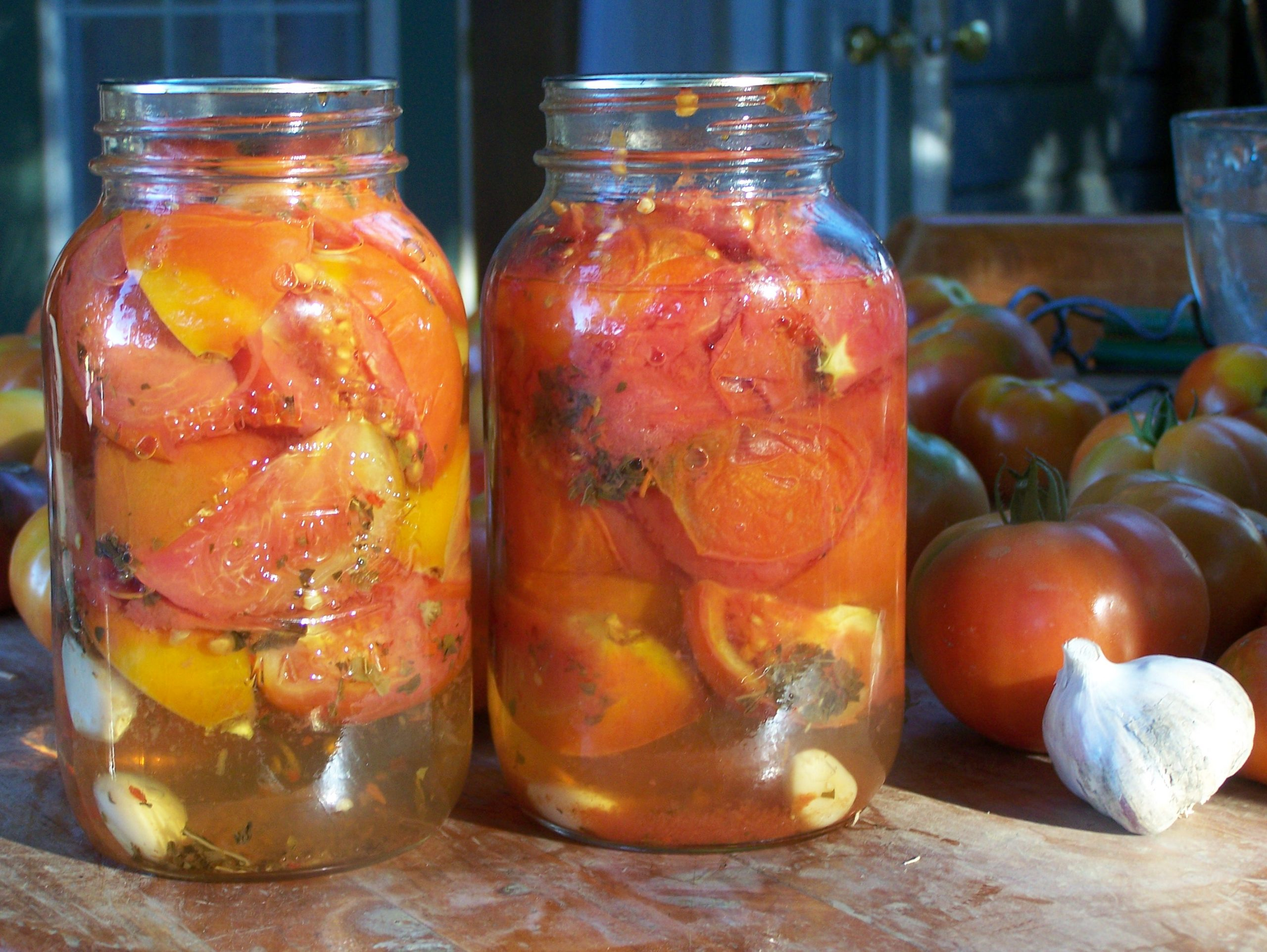 Jars of whole, canned tomatoes