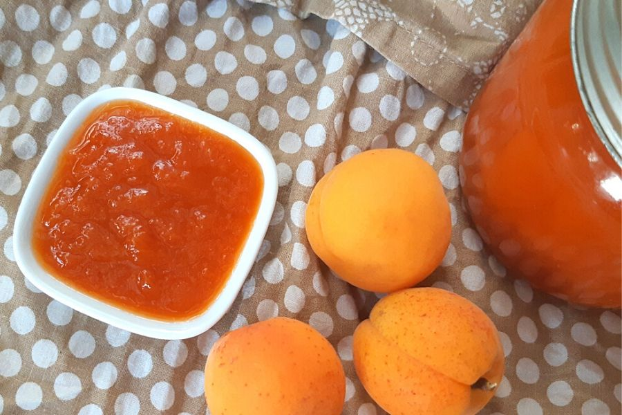 Fresh apricot, new jam and a canned jar of apricot jam