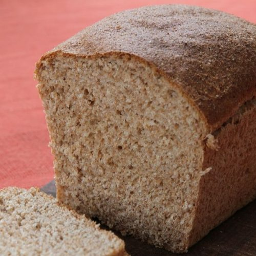 A sliced loaf of whole wheat bread