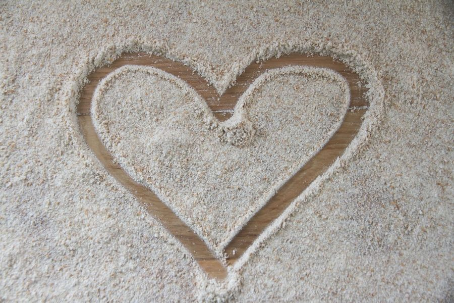 Whole wheat flour with heart drawn in middle