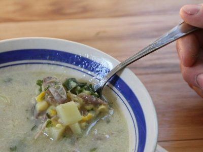 a spoonful of duck and corn chowder
