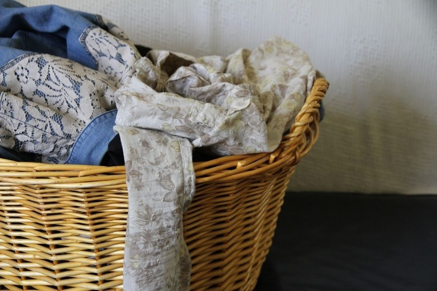 a large basket filled with dirty laundry