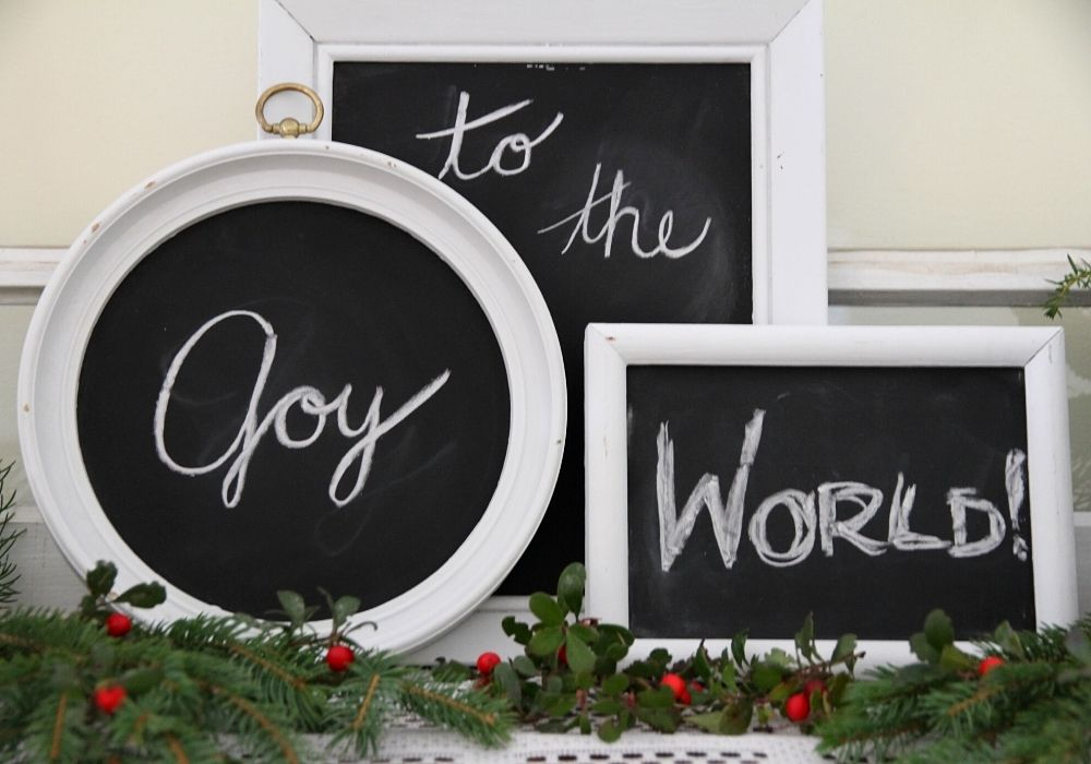 """a group of chalkboards with the words """"Joy to the World"""""""