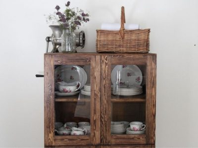 A wooden hutch with glass doors