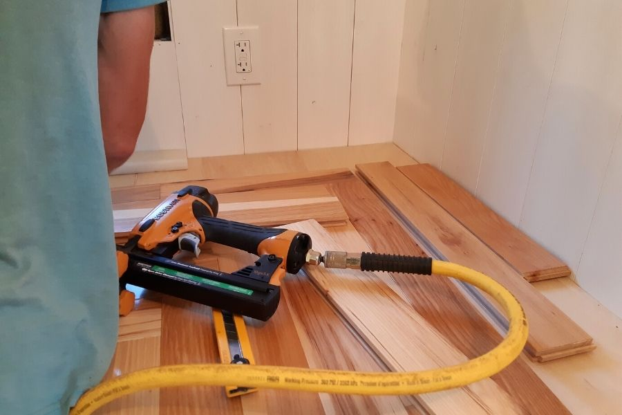 a staple gun lying on top of hickory flooring
