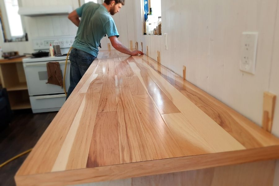 shiny hardwood kitchen counters that need to be sanded down