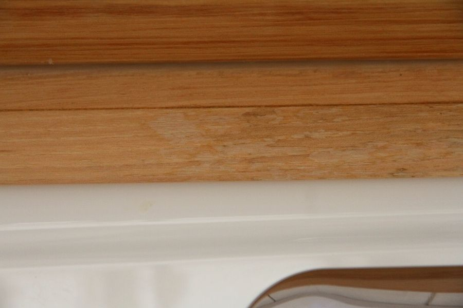 waterstain behind the kitchen sink on the hardwood kitchen counters
