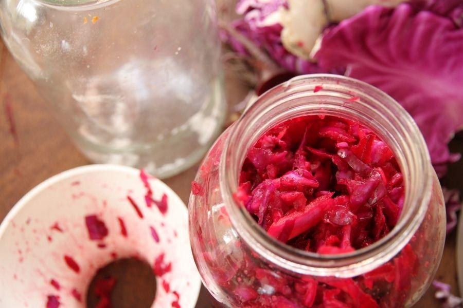 a jar of fermenting purple cabbage sauerkraut