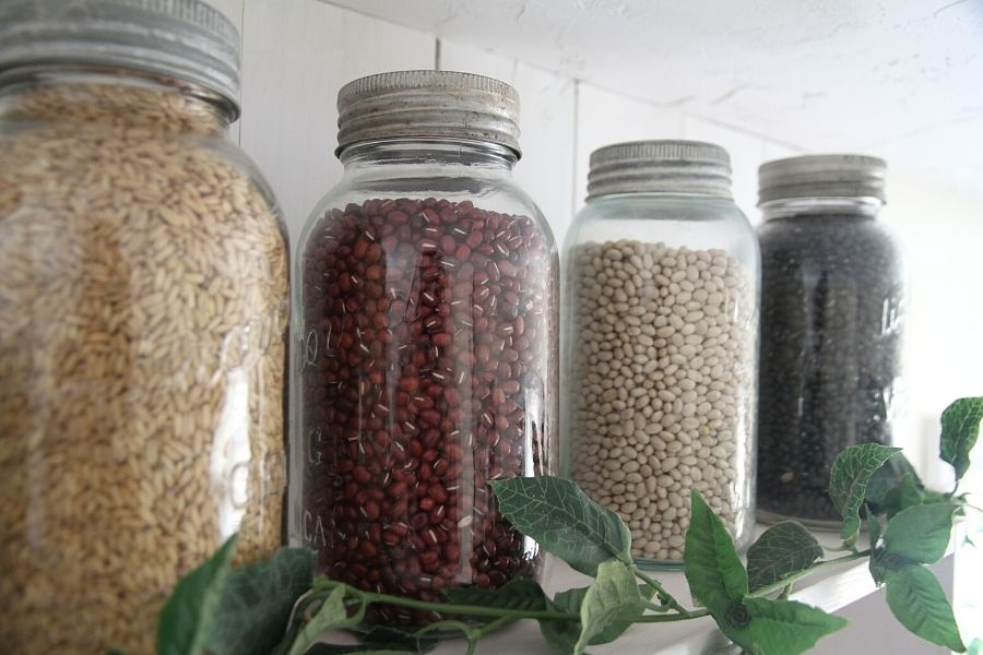 a row of mason jars filled with dry goods