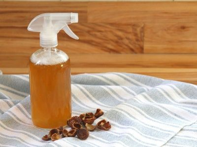 A spray bottle holding my diy natural bathroom cleaner recipe