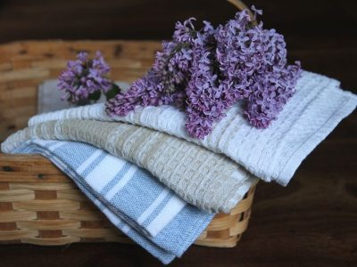 a basket draped with freshly washed tea towels
