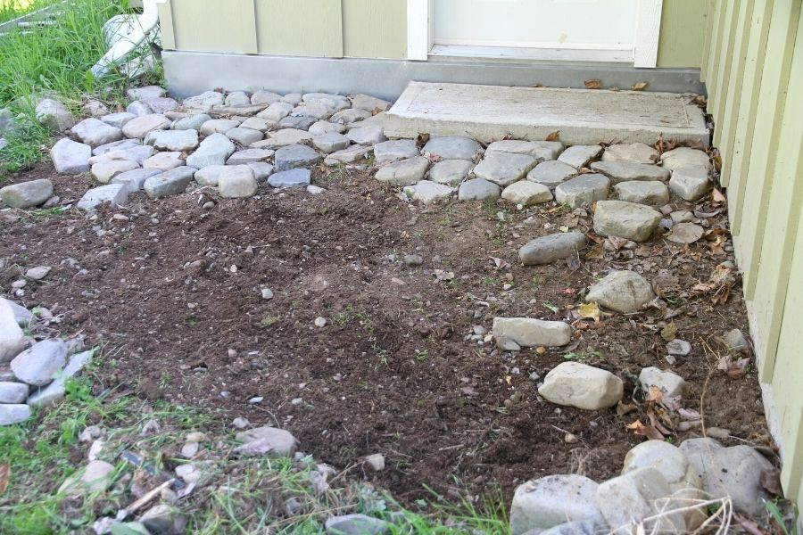 A grass-free area where I show you how to lay a river rock patio