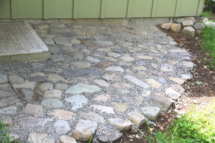 embedded river rock with a gravel finish to fill in cracks